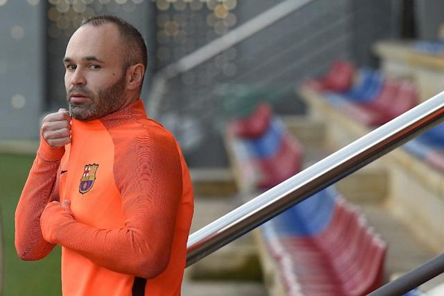 Barcelona's midfielder Andres Iniesta has indicated this summer's World Cup in Russia could signal his international swansong (AFP Photo/LLUIS GENE)