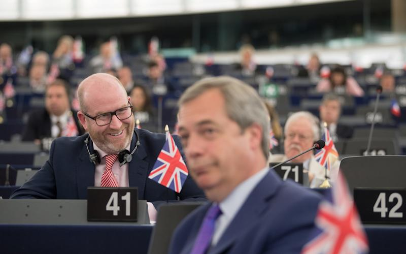 Paul Nuttall (background) and Nigel Farage - Credit: Jasper Juinen/Bloomberg