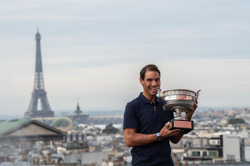 Spain's Rafael Nadal holds the Mousquetaires Cup (The Musketeers) during a photocall a day after winning the men's singles of The Roland Garros 2020.