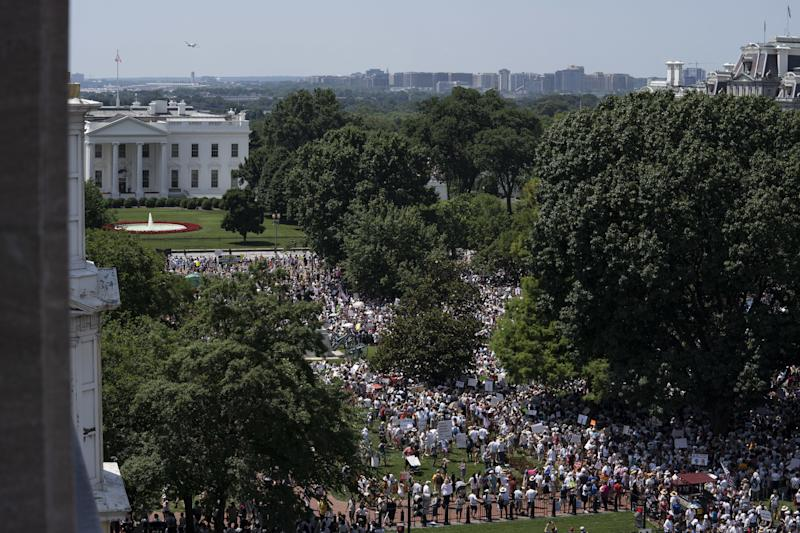 Demonstrators gather outside the White House in Washington, D.C., during a protest against the Trump administration's policy on separating immigrant families.