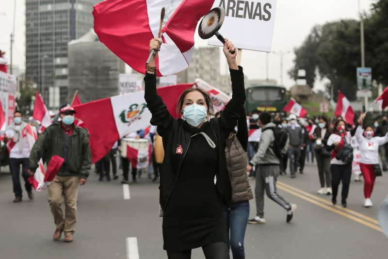 Supporters of socialist Pedro Castillo and right-wing Keiko Fujimori march demanding victory for their respective candidates, in Lima