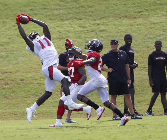 Atlanta Falcons wide receiver Julio Jones (11) makes a catch as cornerback Ricardo Allen (37) and defensive back Robert Alford (23) defend during NFL football training camp, Tuesday, Aug. 7, 2018, in Flowery Branch, Ga. (AP Photo/John Bazemore)