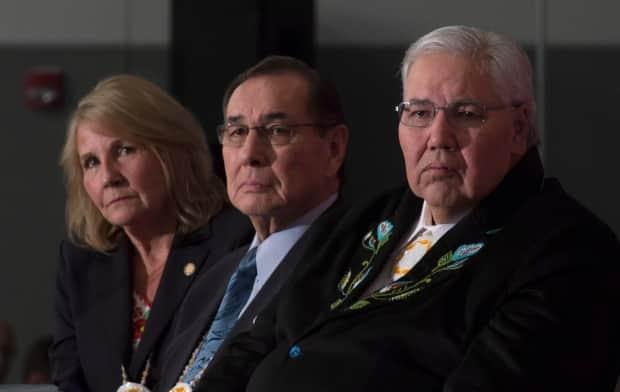 Right to left, Commissioner Justice Murray Sinclair, Commissioner Chief Wilton Littlechild and Commissioner Marie Wilson listen to a speaker as the final report of the Truth and Reconciliation commission is released on Dec. 15, 2015, in Ottawa.