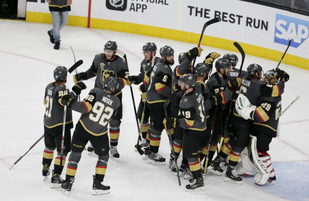 Vegas Golden Knights celebrate the team's 3-2 win against the Winnipeg Jets during Game 4 of the NHL hockey Western Conference finals Friday, May 18, 2018, in Las Vegas. (AP Photo/Marc Sanchez)