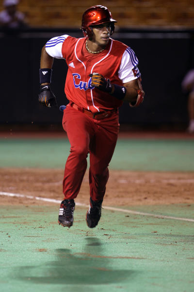 FILE - In this Oct. 4, 2010 file photo, Cuba's Yulieski Gourriel runs to first base after hitting against Nicaragua during a Baseball World Cup qualifier game in Carolina, Puerto Rico. A top active player in Cuba's National Series, second and third baseman Gourriel hit .314 last season. Cuba on Friday, Sept. 27, 2013 announced that athletes from all sports will soon be able to ply their trade in foreign leagues. (AP Photo/Ricardo Arduengo, File)