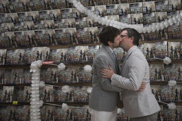 Jason Welker (L) and Scott Everhart kiss after exchanging vows during their wedding ceremony at a comic book retail shop in Manhattan, New York June 20, 2012.