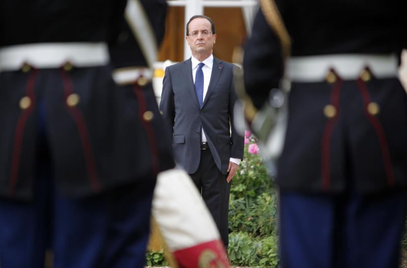 New French President Francois Hollande stands at soldiers during a ceremony Tuesday, May 15, 2012 in the garden of the Elysee Palace in Paris. (AP Photo/Thibault Camus, Pool)