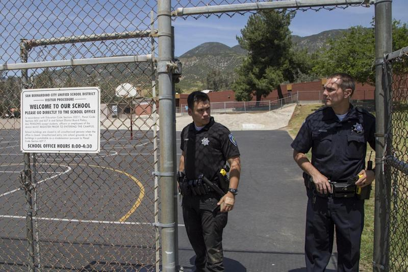 San Bernardino police offers stand guard at North Park Elementary School (Getty Images)