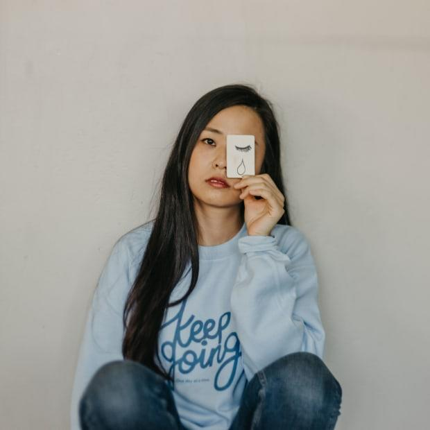 "<em>Self-Care Is for Everyone's </em><a href=""https://selfcareisforeveryone.com/products/keep-going-supporting-the-american-foundation-for-suicide-prevention-sweatshirt"" rel=""nofollow noopener"" target=""_blank"" data-ylk=""slk:&quot;Keep Going&quot; sweatshirt"" class=""link rapid-noclick-resp""><em>""</em>Keep Going"" sweatshirt</a>, supporting the American Foundation for Suicide Prevention<em>. </em>"