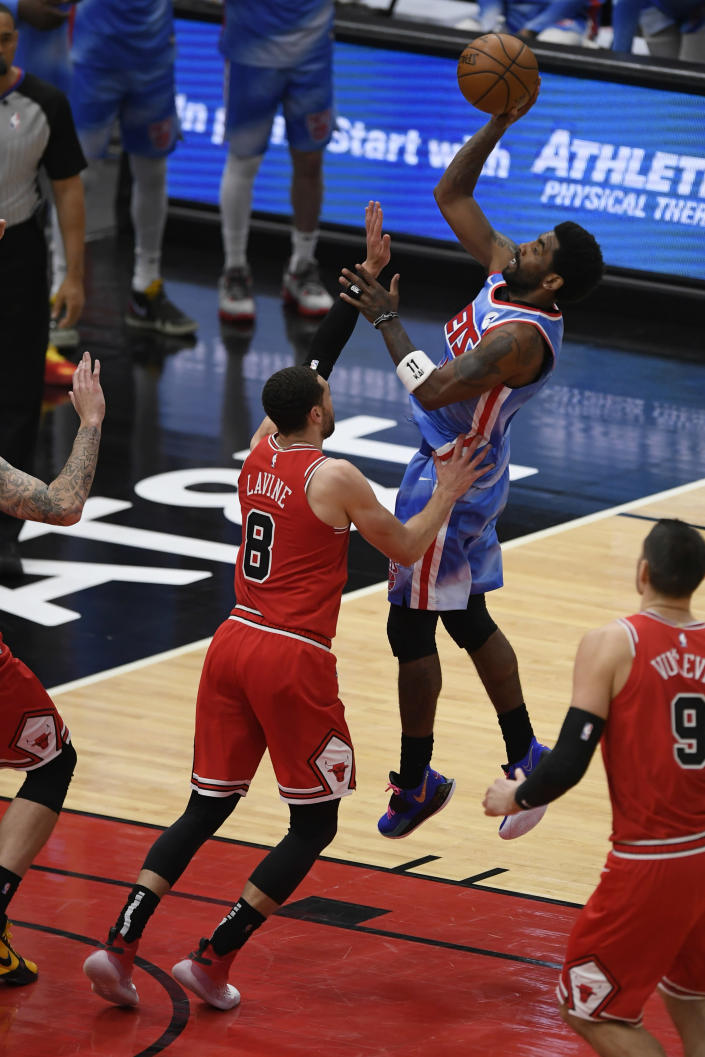 Brooklyn Nets' Kyrie Irving (11) goes up for a shot against Chicago Bulls' Zach Lavine (8) during the first half of an NBA basketball game Sunday, April 4, 2021, in Chicago. (AP Photo/Paul Beaty)
