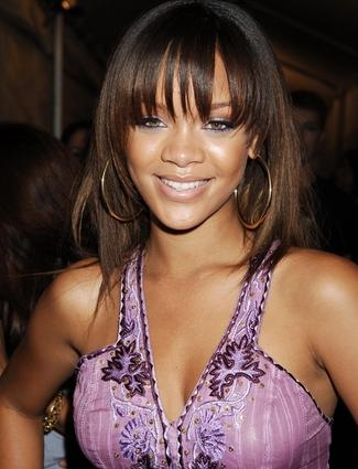 """<div class=""""celebname""""><a target=""""_blank"""" href=""""/virtual-makeover/celebrity-hairstyles/rihanna/"""">Sweet 16</a>                                                   </div><!--  Slide Title  -->                                                                                                    <p>                                                     <span class=""""infotext"""">Rihanna's new album <em>Talk That Talk</em> drops today and what better way to celebrate how far the Caribbean queen has come than by taking a walk down memory lane. The 23-year-old Barbados-born singer burst onto the music scene in 2005 with a sweet and innocent look and her (gasp!) natural brown hair color. <br></span>                                                       <br>                                                        <a target=""""_blank"""" href=""""/virtual-makeover/celebrity-hairstyles/rihanna/"""" class=""""callout"""">Try on Rihanna's hairstyles in the Makeover Studio!</a><!--  Slide Link  -->                                                       <br>                                                        <br>                                                    </p>"""