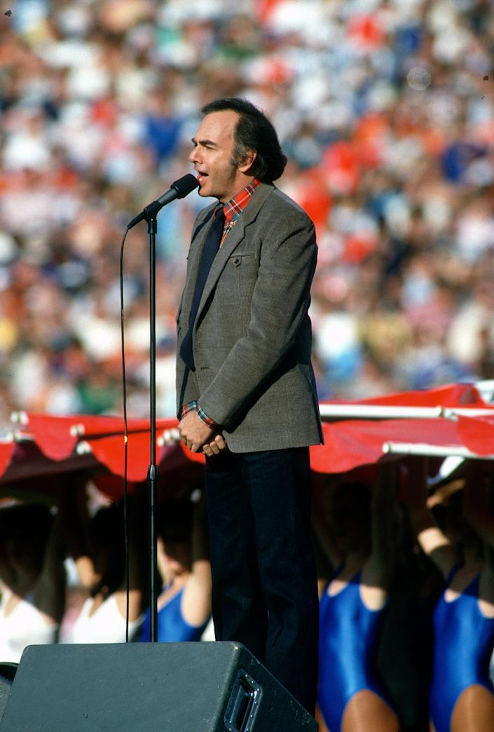 Neil Diamond sings the National Anthem prior to Super Bowl XXI between the Denver Broncos and New York Giants on January 26, 1987 at the Rose Bowl in Pasadena, California. The Giants won the Super Bowl 39 -20.