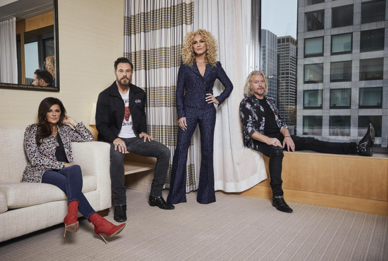 """This Jan. 13, 2020 photo shows members of the country group Little Big Town, from left, Karen Fairchild, Jimi Westbrook, Kimberly Schlapman and Phillip Sweet posing for a portrait in New York to promote their new album """"Nightfall,"""" out on Friday.  (Photo by Matt Licari/Invision/AP)"""