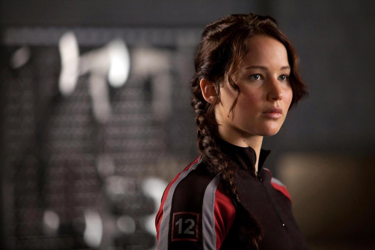 """<p>In this popular young-adult film, <a class=""""sugar-inline-link ga-track"""" title=""""Latest photos and news for Jennifer Lawrence"""" href=""""https://www.popsugar.com/Jennifer-Lawrence"""" target=""""_blank"""" data-ga-category=""""Related"""" data-ga-label=""""https://www.popsugar.com/Jennifer-Lawrence"""" data-ga-action=""""&lt;-related-&gt; Links"""">Jennifer Lawrence</a> stars as Katniss Everdeen, a teenager who volunteers as tribute for her district during a dystopian time period when children from different districts fight each other to the death for a televised pageant called the Hunger Games. There's not much magic or witchcraft in <strong>The Hunger Games</strong> (or its sequels <strong>Catching Fire</strong>, <strong>Mockingjay – Part 1</strong>, and <strong>Mockingjay – Part 2</strong>), but its tale of youth defying corrupt authority figures will make brave-hearted Harry Potter fans feel a certain kind of way.</p> <p><strong>Where to watch: </strong><a href=""""https://www.popsugar.com/buy?url=http%3A%2F%2Fwww.amazon.com%2Fdp%2FB008Z9YLV2&p_name=Amazon&retailer=amazon.com&evar1=buzz%3Aus&evar9=44716648&evar98=https%3A%2F%2Fwww.popsugar.com%2Fphoto-gallery%2F44716648%2Fimage%2F44716652%2FHunger-Games&list1=movies&prop13=api&pdata=1"""" rel=""""nofollow"""" data-shoppable-link=""""1"""" target=""""_blank"""" class=""""ga-track"""" data-ga-category=""""Related"""" data-ga-label=""""http://www.amazon.com/dp/B008Z9YLV2"""" data-ga-action=""""In-Line Links"""">Amazon</a>, <a href=""""https://itunes.apple.com/us/movie/the-hunger-games/id521035514"""" target=""""_blank"""" class=""""ga-track"""" data-ga-category=""""Related"""" data-ga-label=""""https://itunes.apple.com/us/movie/the-hunger-games/id521035514"""" data-ga-action=""""In-Line Links"""">iTunes</a></p>"""