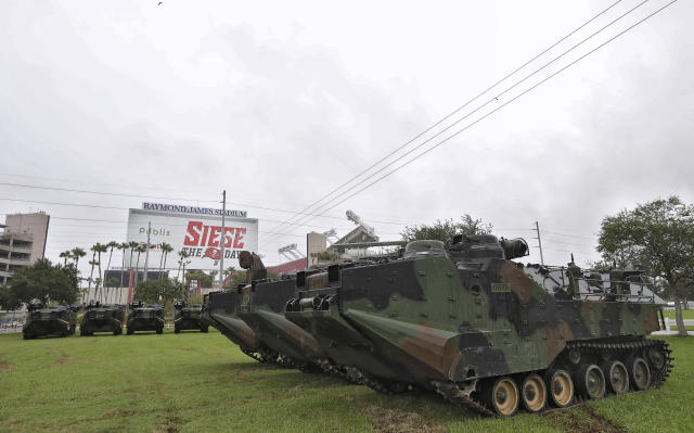 National Guard vehicles were staged outside Raymond James Stadium in Tampa in advance of Hurricane Irma. (AP)