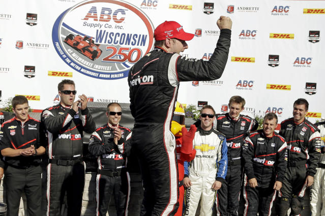 Will Power celebrates after winning the Milwaukee Mile IndyCar auto race Sunday, Aug. 17, 2014, in West Allis, Wis. (AP Photo/Morry Gash)