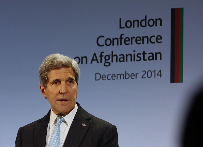 US Secretary of State John Kerry addresses delegates during the London Conference on Afghanistan on December 4, 2014 (AFP Photo/Alastair Grant)