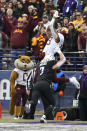 Minnesota wide receiver Rashod Bateman (13) catches a touchdown pass against Northwestern safety Travis Whillock (7) during the first half of an NCAA football game Saturday, Nov. 23, 2019, in Evanston, Ill. (AP Photo/Paul Beaty)
