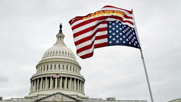 PHOTO: A flag waves upside down in front of the U.S. Capitol grounds in Washington, D.C. on Jan. 06, 2021.  (The Washington Post via Getty Images, FILE)
