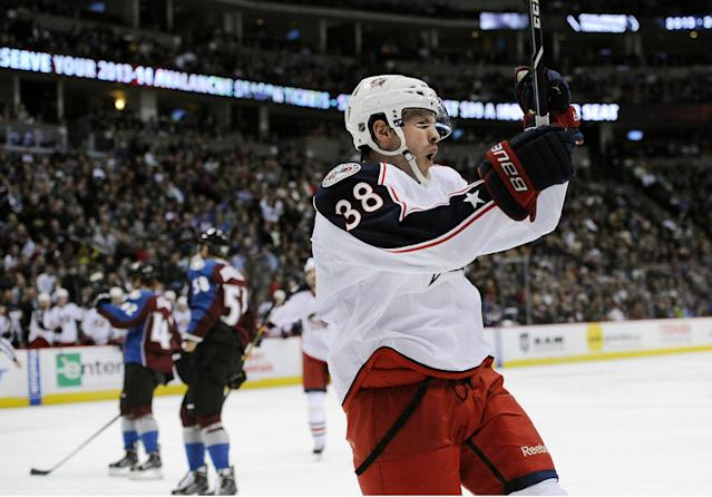Columbus Blue Jackets center Boone Jenner celebrates a goal during the second period of an NHL hockey game against the Colorado Avalanche on Tuesday, Dec. 31, 2013, in Denver. (AP Photo/Chris Schneider)