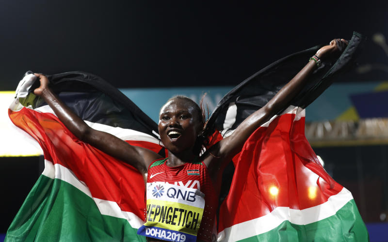 Ruth Chepngetich, of Kenya, celebrates winning the women's marathon at the World Athletics Championships in Doha, Qatar, Saturday, Sept. 28, 2019. (AP Photo/Petr David Josek)