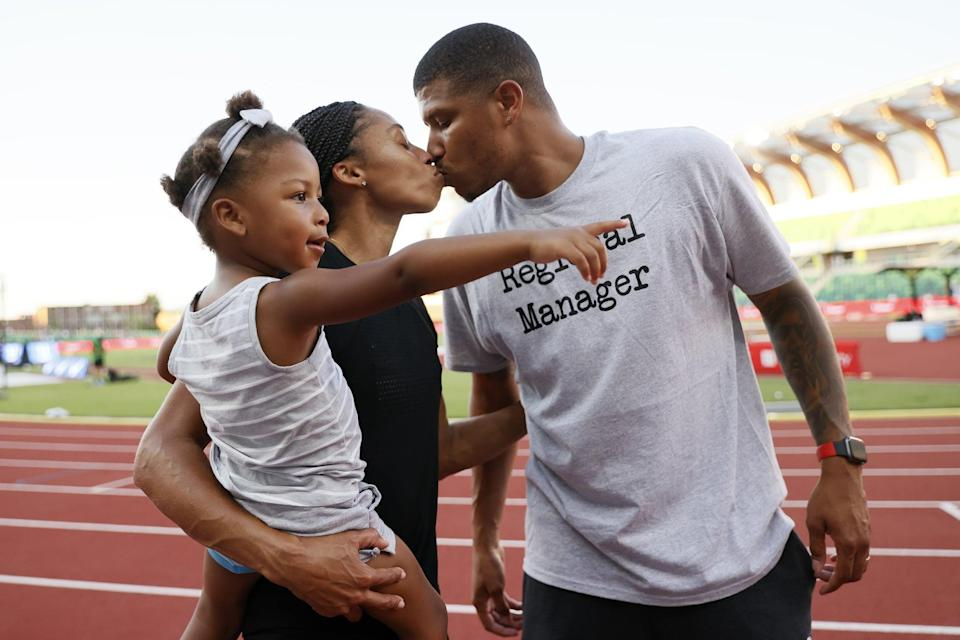 EUGENE, OREGON - JUNE 26: Allyson Felix kisses her husband Kenneth Ferguson while holding her daughter Camryn after day nine of the 2020 U.S. Olympic Track & Field Team Trials at Hayward Field on June 26, 2021 in Eugene, Oregon. (Photo by Steph Chambers/Getty Images)