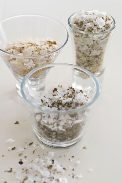 In this image taken on Oct. 22, 2012, savory salt combinations from top left clockwise, curry, fennel seed and oregano are shown in Concord, N.H. (AP Photo/Matthew Mead)