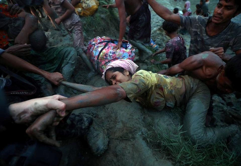 "<div class=""inline-image__caption""><p>Photographers help a Rohingya refugee to come out of Nad River as they cross the Myanmar-Bangladesh border in Palong Khali, near Cox's Bazar, Bangladesh, November 1, 2017. </p></div> <div class=""inline-image__credit"">Hannah McKay/Reuters</div>"