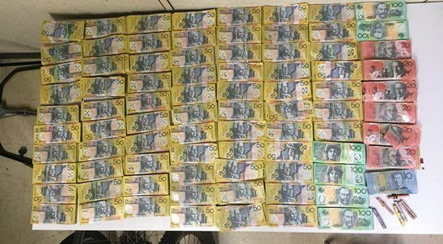 Officers allege $426,000 in cash was found during the raid. Source: Queensland Police Service