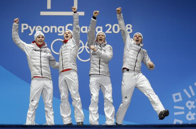 Medals Ceremony - Nordic Combined Events - Pyeongchang 2018 Winter Olympics - Men's Team 4 x 5 km - Medals Plaza - Pyeongchang, South Korea - February 23, 2018 - Gold medalists Vinzenz Geiger, Fabian Riessle, Eric Frenzel and Johannes Rydzek of Germany on the podium. REUTERS/Eric Gaillard