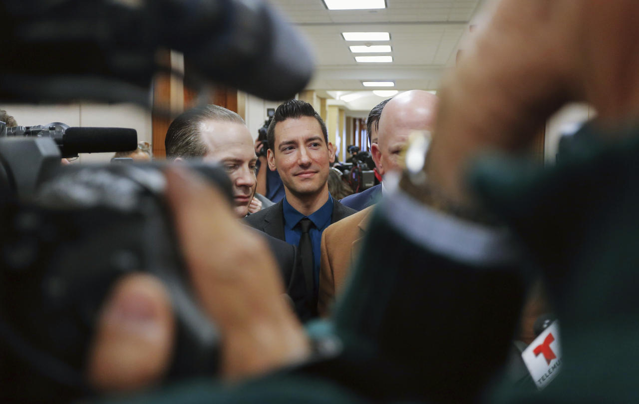 "FILE - In this Feb. 4, 2016 file photo, David Daleiden, center, one of the two anti-abortion activists who released secretly recorded videos alleging that Planned Parenthood sold fetal tissue to researchers, addresses the media with attorneys Jared Woodfill, left, and Terry Yates after turning himself in to authorities in Houston. w judge should disqualify himself from a lawsuit over an anti-abortion group's videos says he could not readily discern any appearance of bias. U.S. District Court Judge James Donato said Thursday, June 22, 2017, he was having trouble understanding how Judge William Orrick's affiliation with a non-profit and two Facebook ""likes"" by Orrick's wife created an appearance of bias against defendant David Daleiden. (AP Photo/Bob Levey)"