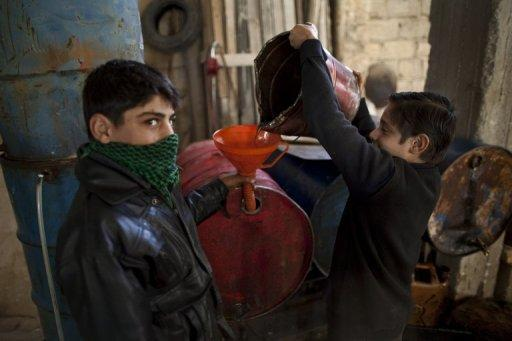 <p>Syrian youths fill jerrycans with fuel in the northern Syrian town of Azaz on December 25, 2012. The UN-Arab League peace envoy for Syria, Lakhdar Brahimi, was to hold talks in Moscow Saturday to find a way out of the Syria conflict after Russia upped the pressure on President Bashar al-Assad to open talks with the rebels.</p>