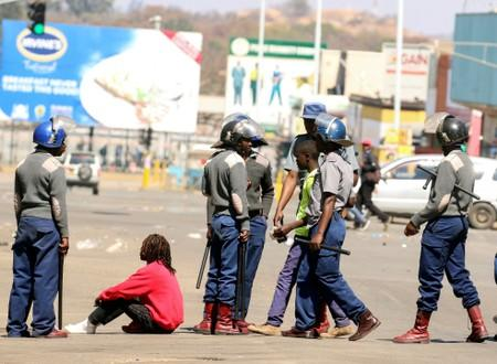 Riot police detain protesters during clashes after police banned planned protests over austerity and rising living costs called by the opposition Movement for Democratic Change (MDC) party in Harare