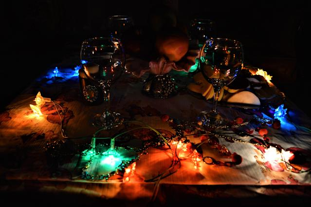 <p>Lights illuminate a decorated table for the New Year's celebrations during New Year's Eve in Ankara, Turkey on December 31, 2017. (Photo: Altan Gocher/Getty Images) </p>