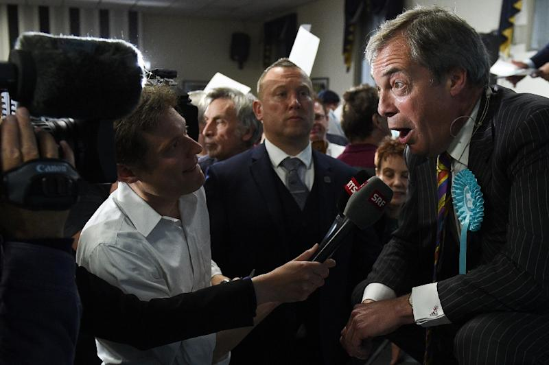 The rise of former commodities trader Nigel Farage is one of the striking consequences of government failure to lead Britain out of the European Union on time (AFP Photo/Oli SCARFF                          )