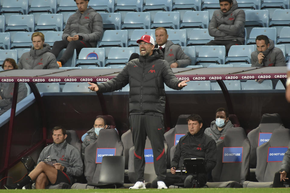 Liverpool's manager Jurgen Klopp shouts out from the touchline during the English Premier League soccer match between Aston Villa and Liverpool at the Villa Park stadium in Birmingham, England, Sunday, Oct. 4, 2020. (AP Photo/Rui Vieira, Pool)