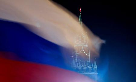 Russian flag flies with the Spasskaya Tower of Moscow's Kremlin in the background in Moscow, Russia February 27, 2019. REUTERS/Maxim Shemetov