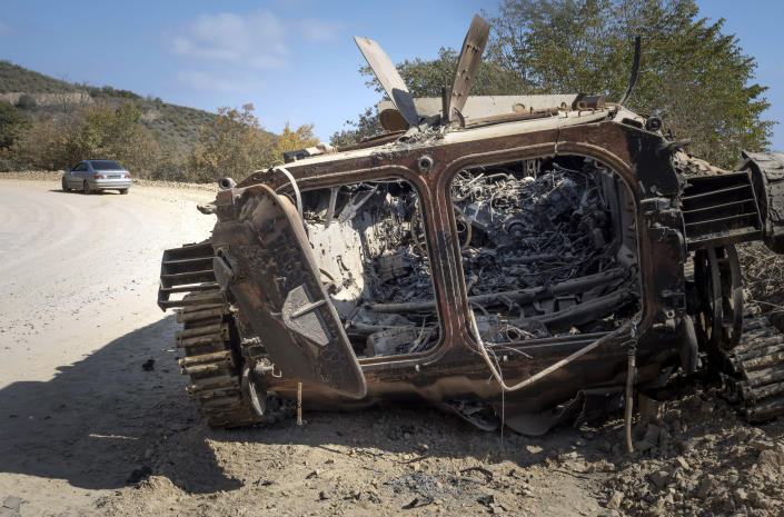 A destroyed Armenian APC is seen on the road from Stepanakert to Martekert during a military conflict in the separatist region of Nagorno-Karabakh, Thursday, Oct. 15, 2020. The conflict between Armenia and Azerbaijan is escalating, with both sides exchanging accusations and claims of attacks over the separatist territory of Nagorno-Karabakh.(AP Photo)