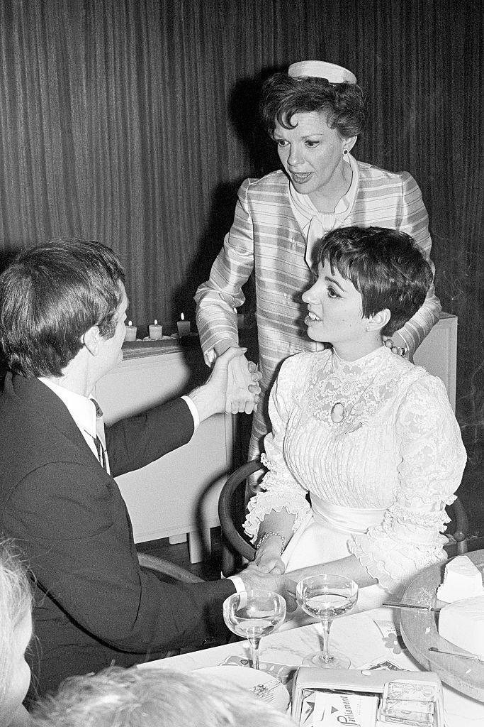 <p>Actress and singer Liza Minnelli sits with her husband, Australian musician Peter Allen, following their New York City wedding ceremony on March 3, 1967. As seen here, Minnelli's mother, actress Judy Garland, chats up the newlyweds. Their marriage eventually dissolved in 1974, and Minnelli went on to marry three more times, while he never walked down the aisle again.</p>