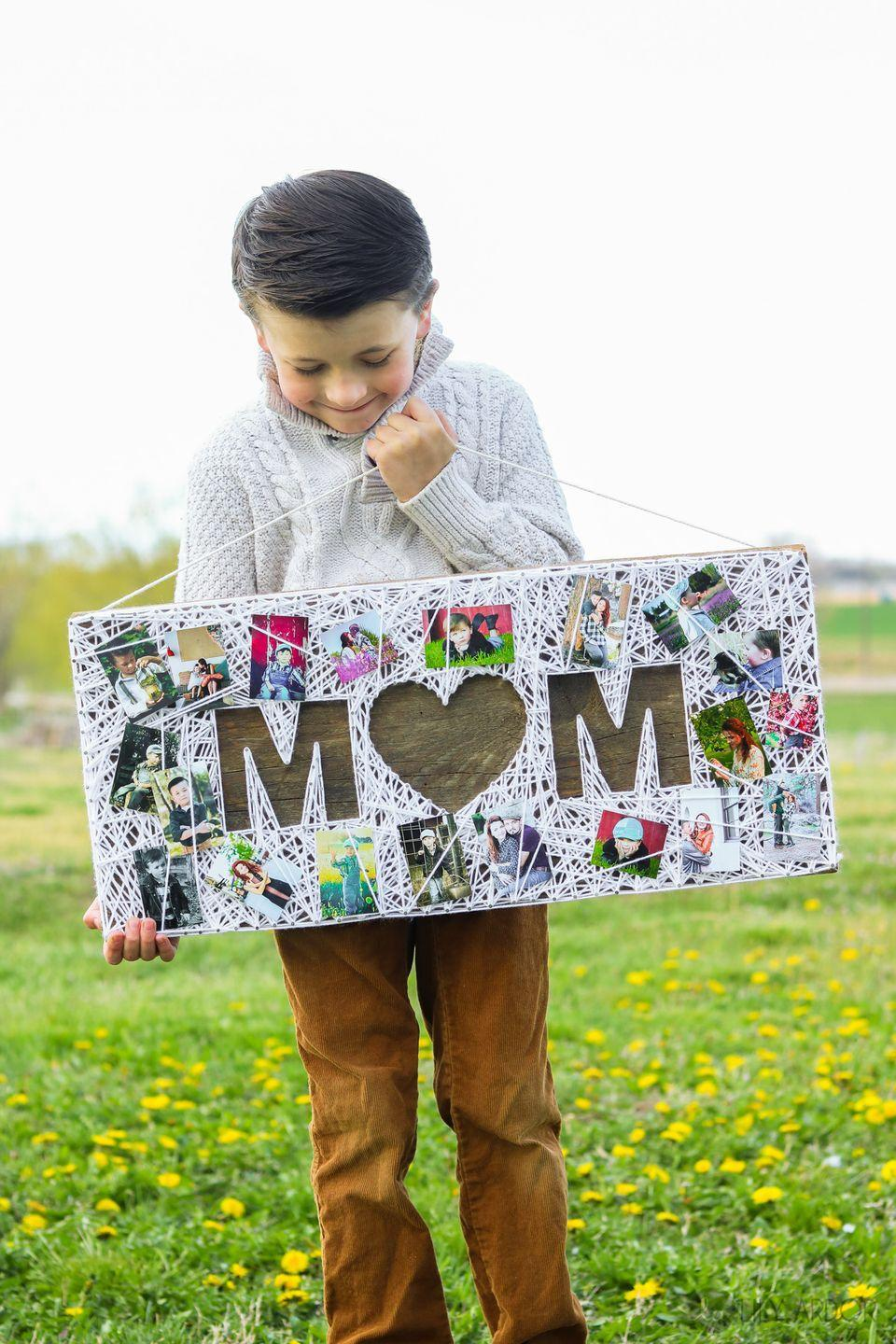 """<p>Instead of getting mom <em>another </em>picture frame, make her a piece of wall art that can hold all of her family photos in one charming, handmade place.</p><p><em><strong>Get the tutorial from <a href=""""https://www.lilyardor.com/mothers-day-string-art-photo-gift/"""" rel=""""nofollow noopener"""" target=""""_blank"""" data-ylk=""""slk:Lily Ardor"""" class=""""link rapid-noclick-resp"""">Lily Ardor</a>. </strong></em></p><p><strong><a class=""""link rapid-noclick-resp"""" href=""""https://www.amazon.com/TYH-Supplies-Acrylic-Assorted-Colors/dp/B00XLP2UGI/ref=sr_1_5?dchild=1&keywords=YARN&qid=1605822340&sr=8-5&tag=syn-yahoo-20&ascsubtag=%5Bartid%7C10063.g.34832092%5Bsrc%7Cyahoo-us"""" rel=""""nofollow noopener"""" target=""""_blank"""" data-ylk=""""slk:SHOP YARN"""">SHOP YARN</a></strong></p>"""