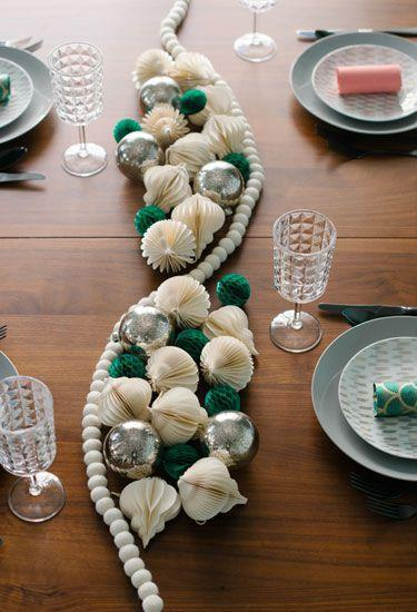 """<p>Blogger Melanie Blodgett traded place settings for DIY party poppers and substitutes a traditional table runner for tissue balls, ornaments, and felt garland. </p><p><strong>Get the tutorial at <a href=""""http://www.youaremyfave.com/2014/11/05/party-popper-place-cards-are-my-fave/"""" rel=""""nofollow noopener"""" target=""""_blank"""" data-ylk=""""slk:You Are My Fave"""" class=""""link rapid-noclick-resp"""">You Are My Fave</a>.</strong></p><p><a href=""""https://www.amazon.com/s/ref=nb_sb_noss_2?url=search-alias%3Dgarden&field-keywords=tissue+paper+ornaments"""" rel=""""nofollow noopener"""" target=""""_blank"""" data-ylk=""""slk:SHOP TISSUE ORNAMENTS"""" class=""""link rapid-noclick-resp"""">SHOP TISSUE ORNAMENTS</a></p>"""