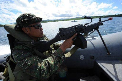 <p>Philippine marines patrol along Ulugan Bay, facing the South China Sea. The United States and the Philippines called for freedom of navigation in the tense South China Sea as the White House offered a robust show of support for President Benigno Aquino.</p>