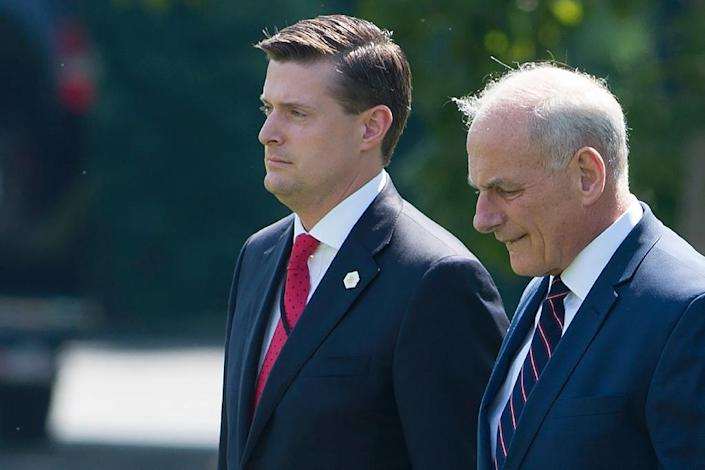 John Kelly (R) proposed a series of tweaks to limit temporary security clearances after Rob Porter (L) worked for months without full clearance (AFP Photo/SAUL LOEB)