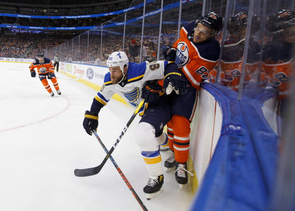 St. Louis Blues' Ryan O'Reilly (90) checks Edmonton Oilers' Caleb Jones (82) during the first period of an NHL hockey game, Tuesday, Dec. 18, 2018 in Edmonton, Alberta. (Jason Franson/The Canadian Press via AP)