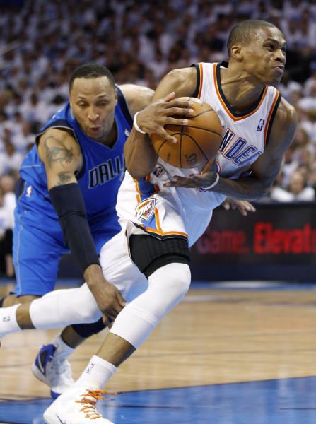 Oklahoma City Thunder guard Russell Westbrook, right, is fouled by Dallas Mavericks forward Shawn Marion, left, as he drives to the basket in the second quarter of Game 2 in the first round of the NBA basketball playoffs, in Oklahoma City, Monday, April 30, 2012. (AP Photo/Sue Ogrocki)