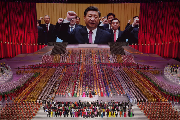 FILE - In this June 28, 2021, file photo, Chinese President Xi Jinping is seen leading other top officials pledging their vows to the party on screen during a gala show ahead of the 100th anniversary of the founding of the Chinese Communist Party in Beijing. An avalanche of changes launched by China's ruling Communist Party has jolted everyone from tech billionaires to school kids. Behind them: Xi's vision of reviving an idealized early era of vigorous party leadership, with more economic equality and tighter control over society and billionaire entrepreneurs. (AP Photo/Ng Han Guan, File)
