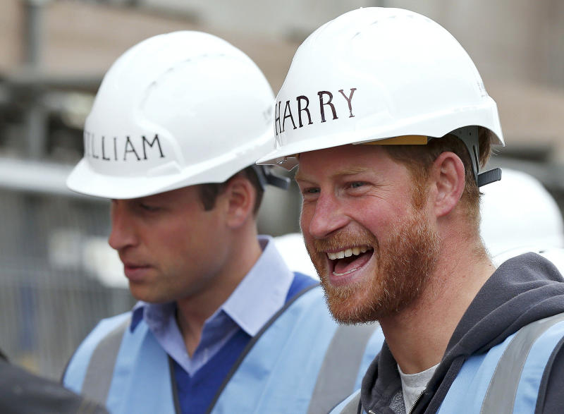Prince Harry (R) laughs next to Prince William, Duke of Cambridge, as they tour a building site in Manchester on September 23, 2015, as part of their visit to the BBC's DIY SOS television show helping to renovate homes for ex-service personnel. (AFP / Phil Nobel/ Pool/ Alain Jocard/ Mandel Ngan/ Saul Loeb/ Oli Scarff/ Toru Yamanaka via Getty Images)