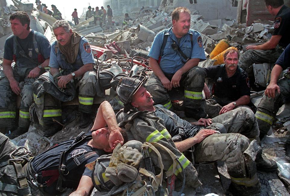 Firefighters lying around and taking a break.