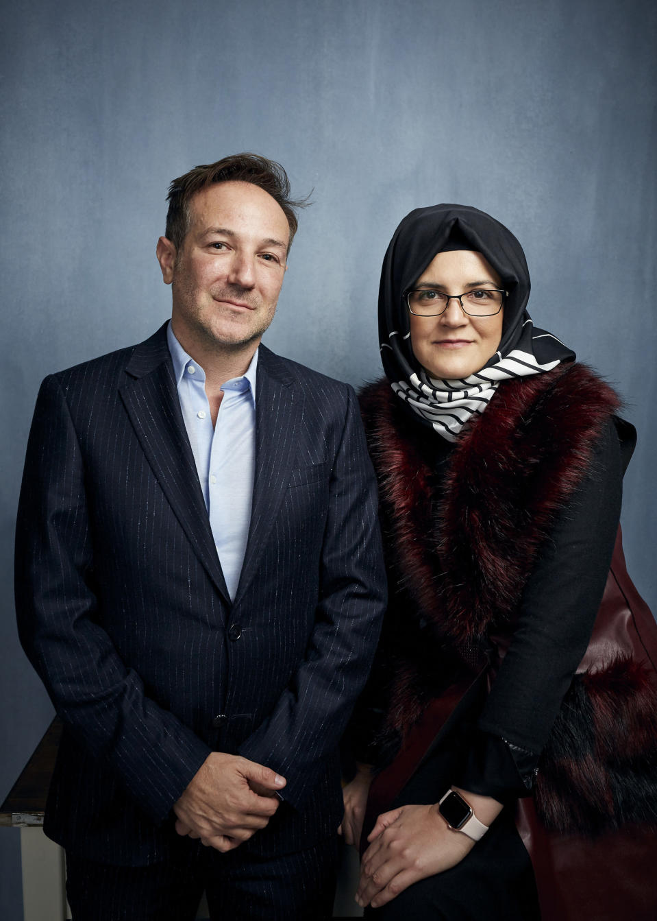 """FILE - Director Bryan Fogel, left, and Hatice Cengiz pose for a portrait to promote """"The Dissident,"""" a film about slain journalist Jamal Khashoggi, during the Sundance Film Festival in Park City, Utah on Jan. 24, 2020. (Photo by Taylor Jewell/Invision/AP, File)"""
