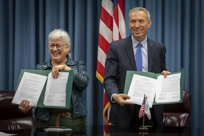 IFYE President Victoria Warren, left, and Deputy Secretary of Agriculture, Stephen Censky hold signed copies of a memorandum of understanding between the two organizations from a ceremony held earlier today.